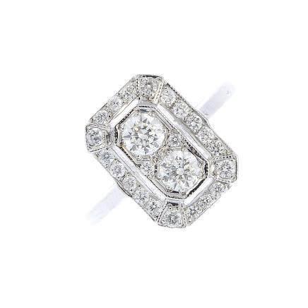 A diamond dress ring. The brilliant-cut diamond line, with similarly-cut diamond halo surround.