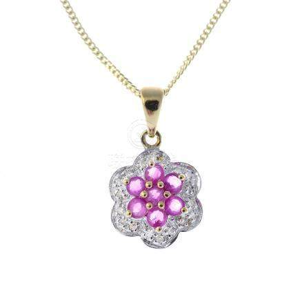 A 9ct gold ruby cluster pendant. The circular-shape ruby cluster, with single-cut diamond