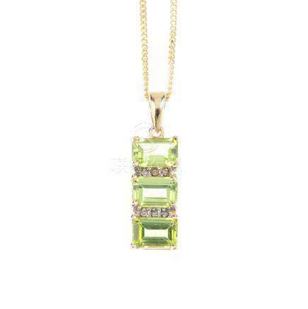 A 9ct gold peridot and diamond pendant. The rectangular-shape peridot line, with single-cut