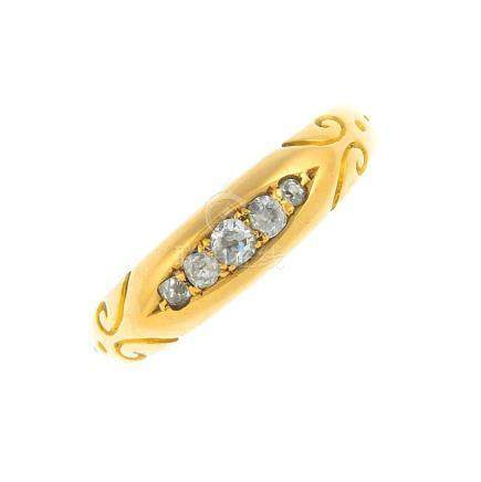 A late Victorian 18ct gold diamond five-stone ring. The graduated old-cut diamond line, with