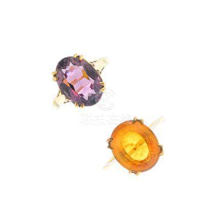 Two gem-set rings. The first designed as a 9ct gold oval-shape citrine with tapered shoulders, the