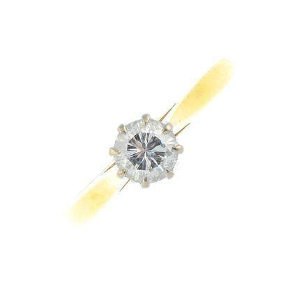 An 18ct gold diamond single-stone ring. The brilliant-cut diamond, with tapered shoulders. Estimated