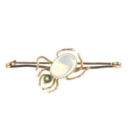 A gem-set spider brooch. The oval opal cabochon abdomen, with circular-shape green tourmaline