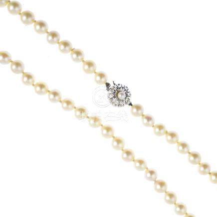 A cultured pearl single-strand necklace. Comprising a single-strand of forty-four cultured pearls,