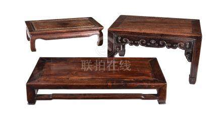 Three Chinese hardwood low tables or stands, late Qing Dynasty