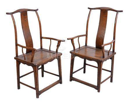 Two Chinese hardwood 'official's hat' armchairs, Qing Dynasty, 18th or 19th century