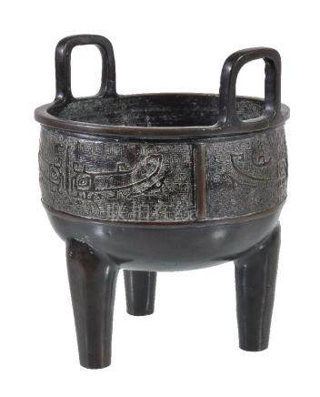 A Chinese archaistic bronze tripod censer