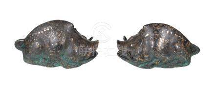 A pair of Chinese archaistic silver inlaid bronze boars