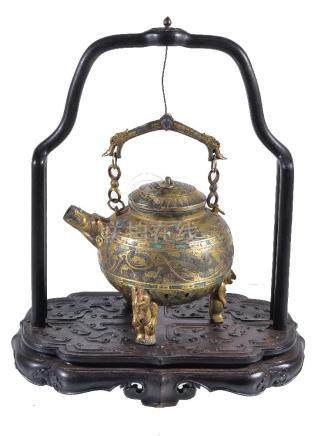 A Chinese archaic style inlaid tripod pouring vessel and cover