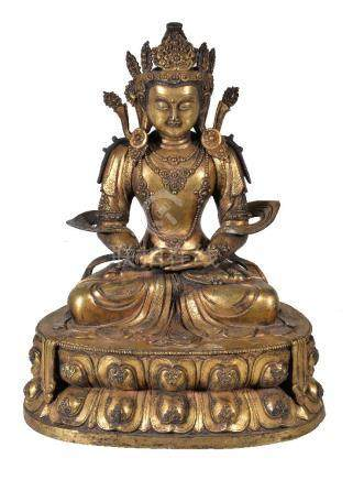 A large Sino-Tibetan gilt-bronze figure of Amitayus