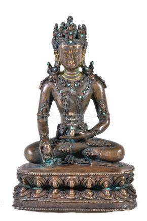 Y A Tibetan bronze figure of Buddha