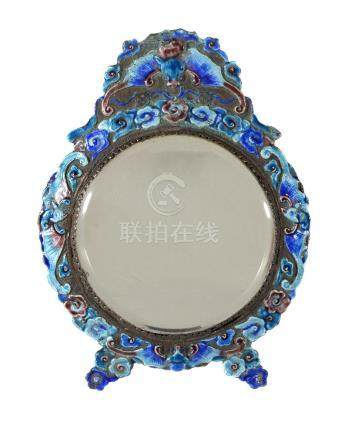 A Chinese enamelled metal mirror