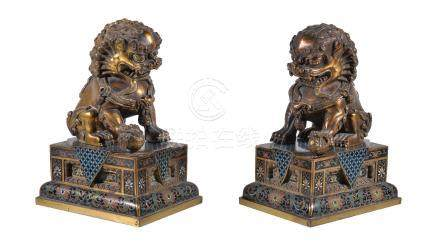 A pair of Chinese gilt-bronze Buddhist lions