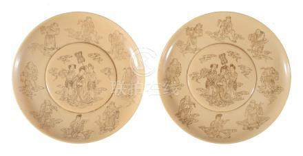 Y A pair of Chinese incised ivory dishes