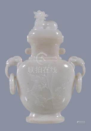 A Chinese white hardstone vase and cover
