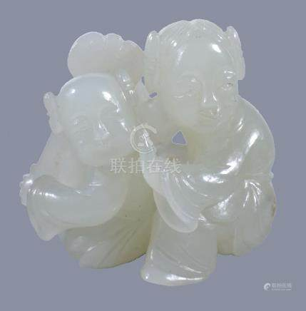 A small white jade group of a mother and child