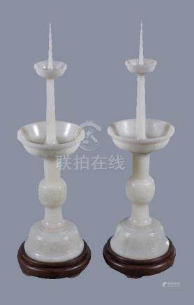 A pair of Chinese white jade candlesticks