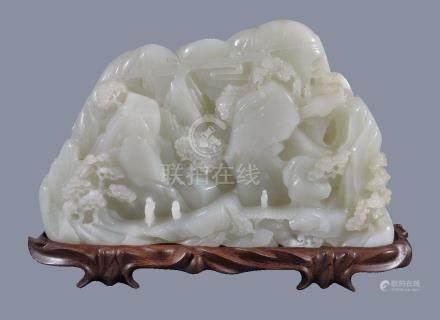 A large white jade 'landscape' boulder carving