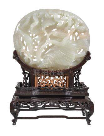 A Chinese white or pale celadon jade Yuan-style oval 'lotus and goose' plaque