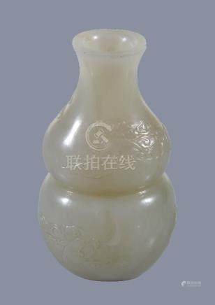 A small Chinese white or pale celadon jade 'bat and cloud' vase