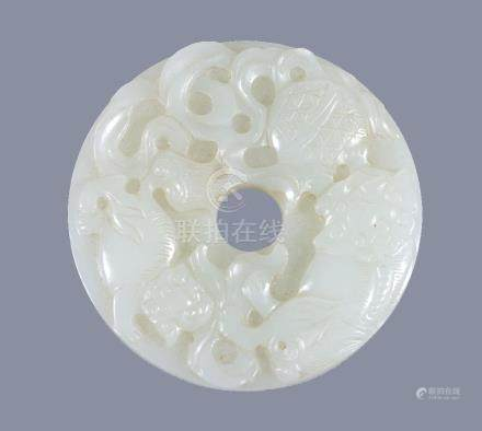 A Chinese white jade 'Buddhist Lion' disc