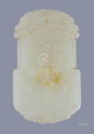 A Chinese white jade or pale celadon pendant