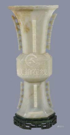 A Chinese celadon jade gu-shaped octagonal vase