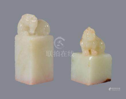 Two Chinese pale celadon 'Buddhist Lion' seals