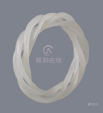 A white jade triple articulated bangle