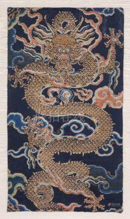 A Chinese brocade fragment of a large coiling five clawed dragon