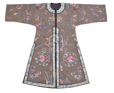 A Chinese olive green silk damask informal jacket