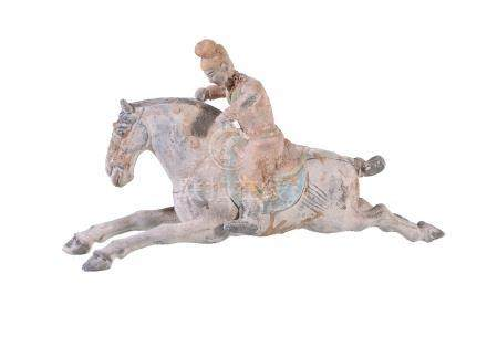 A Chinese painted pottery horse and rider