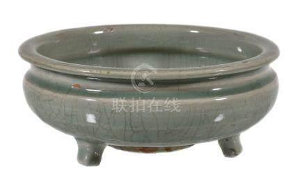 A Chinese celadon tripod censer