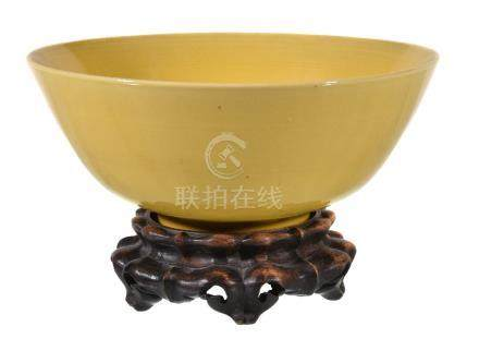 A Chinese yellow-glazed bowl