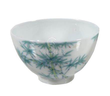 A small Doucai ' Bamboo ' wine cup, delicately potted with deep rounded sides rising ...