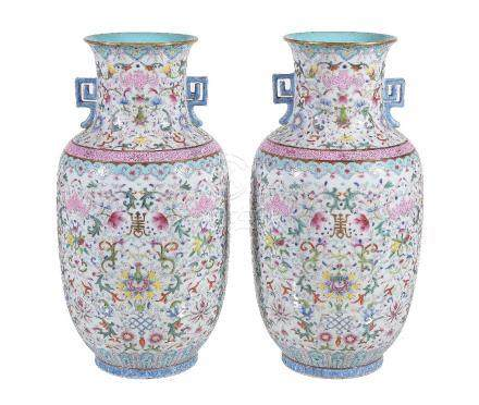 A pair of Chinese Famille Rose two-handled vases