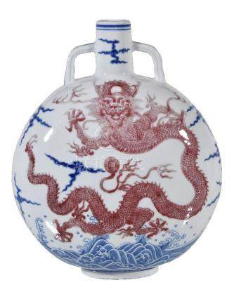 An Imperial-style Chinese blue and copper-red glazed 'dragon' moonflask