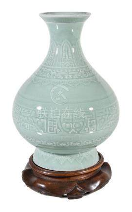 A Chinese celadon carved pear-shaped vase