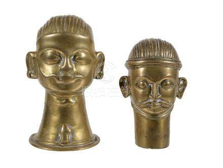 Two Indian brass Lingam covers