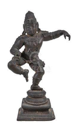 A small bronze dancing figure of Krishna, Southern India, 15-16th century