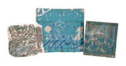 Three Kashan moulded turquoise glazed tiles