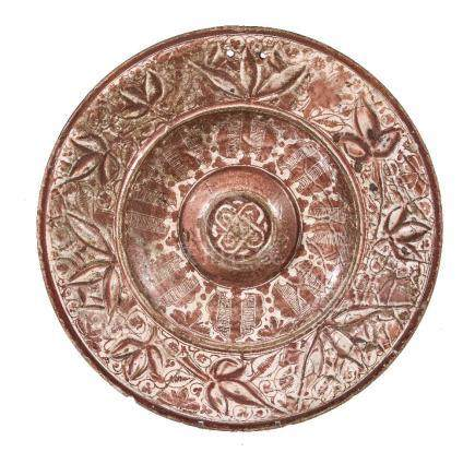 A Hispano-Moresque tin glazed pottery copper lustre charger