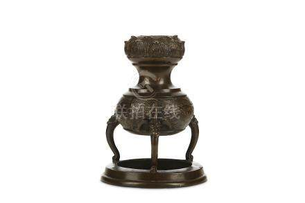 A CHINESE TRIPOD BRONZE INCENSE BURNER. Yuan to Ming Dynasty. The globular body decorated with