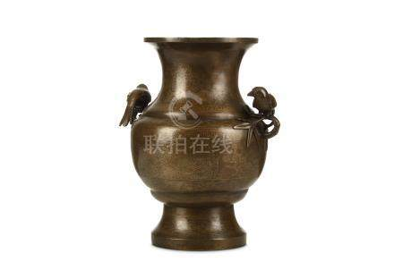 A CHINESE SILVER-INLAID BRONZE VASE. Qing Dynasty, 18th Century. The ovoid body with wide shoulders
