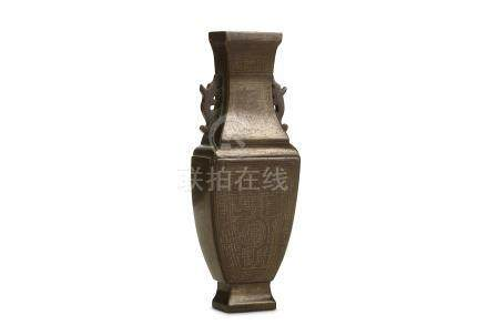 A CHINESE SILVER-INLAID BRONZE WALL VASE. Qing Dynasty, 18th to 19th Century, signed Shisou. The