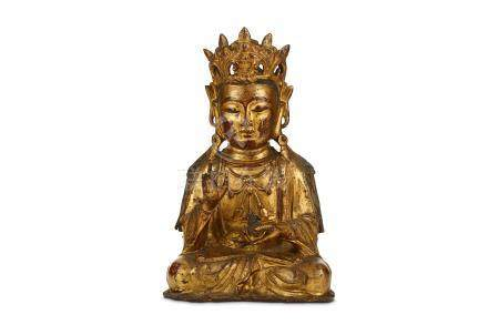 A CHINESE GILT-LACQUER BRONZE FIGURE OF GUANYIN. Ming Dynasty, 17th Century. Seated in dhyanasana,