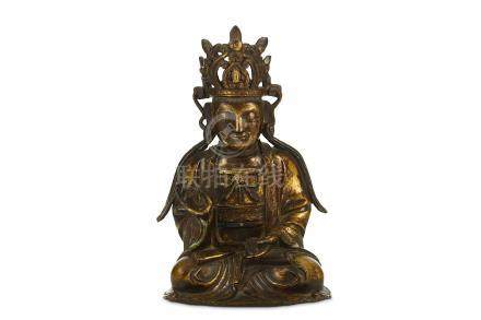 A CHINESE GILT BRONZE FIGURE OF GUANYIN. Ming Dynasty, 17th Century. Seated in dhyanasana, dressed