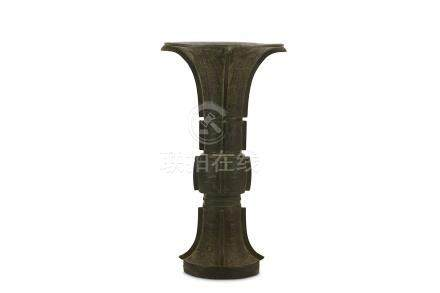 A CHINESE BRONZE VASE, GU. 17th Century. Of archaistic gu form with protruding central section,