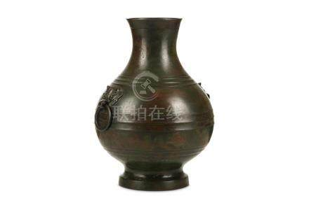 A CHINESE BRONZE VASE, HU. 17th to 18th Century. The globular body rising from a splayed foot to a