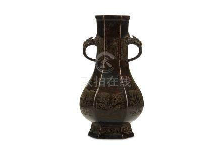 A CHINESE HEXAGONAL BRONZE VASE. Ming Dynasty. Of hexagonal form, the pear-shaped body rising from